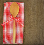 Wooden spoon and red napkin Royalty Free Stock Photo