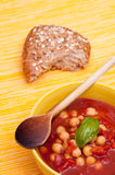 Wooden spoon and red vegetable soup Royalty Free Stock Photos