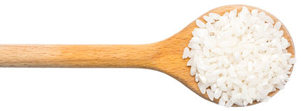 Wooden Spoon With Rice Seeds Stock Images