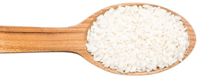 Wooden Spoon With Rice Seeds Stock Photos