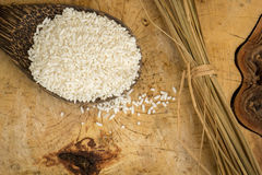 Wooden Spoon rice, wood floors, brown, jasmine rice, surface. Stock Images
