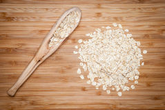 A wooden spoon with rolled oats Stock Images