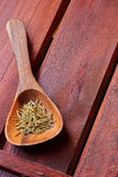 Wooden spoon with rosemary Royalty Free Stock Photos