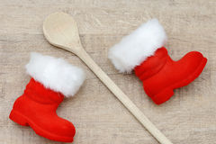 Wooden spoon and santa boots Stock Photography