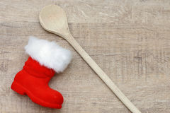 Wooden spoon and santa boots Stock Photos