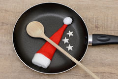 Wooden spoon and santa hat Stock Photo