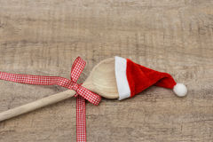 Wooden spoon and santa hat Royalty Free Stock Photos