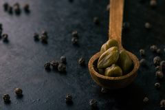 Wooden spoon with several capers Stock Image