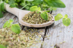 Wooden Spoon with shredded Oregano Royalty Free Stock Images