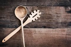 Wooden Spoon and Spaghetti Fork over Wood Background Royalty Free Stock Photos