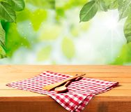 Wooden spoon and spatula on checkered napking. Table color red white background nobody view Stock Photography