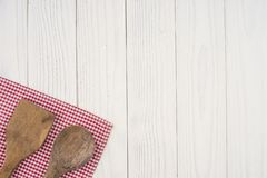 Wooden spoon and spatula on an old white table. Top view stock images