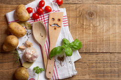 Wooden spoon, spatula and spices Stock Images
