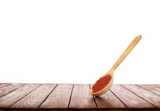Wooden spoon with spices on a wooden background on a white backg. Wooden spoon with spices, on a wooden background on a white background Stock Photos