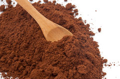 Wooden spoon and spilled ground coffee Stock Photo