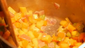 Wooden spoon stirring hot vegetables stock video