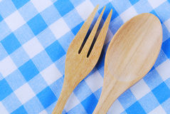 Wooden spoon,  tablecloth, fork on table. Background Stock Photo