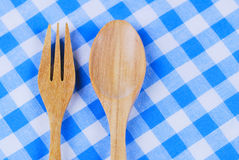 Wooden spoon,  tablecloth, fork on table. Background Stock Photography
