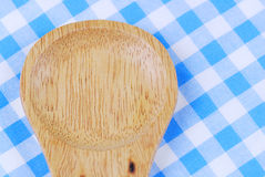 Wooden spoon,  tablecloth, fork on table. Background Royalty Free Stock Photo