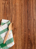 Wooden spoon on a towel in the green square Royalty Free Stock Image