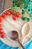 Wooden spoon on tray with tomato Royalty Free Stock Image