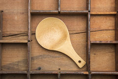 Wooden spoon on typeset tray. Royalty Free Stock Image