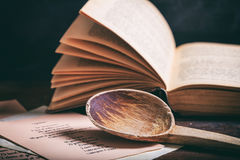 Wooden spoon and a vintage book Royalty Free Stock Images