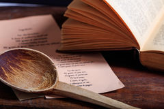 Wooden spoon and a vintage book Royalty Free Stock Image