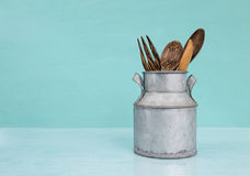 Wooden spoon in vintage metal can royalty free stock photo