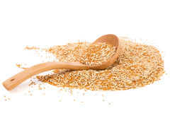 Wooden spoon of wheat with husk and purified. Royalty Free Stock Photo