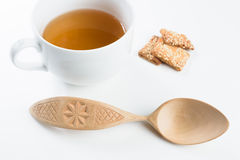 Wooden spoon on white background. Wooden spoon with pattern on white background stock photo