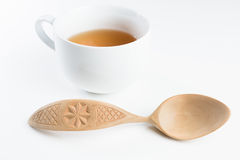 Wooden spoon on white background. Wooden spoon with pattern on white background stock photos