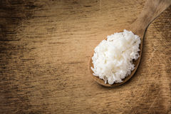 Wooden spoon white boiled rice on wood background Stock Photography