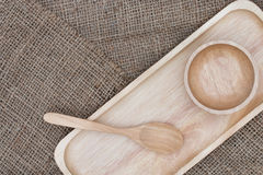 Wooden spoon and wooden cup placed on the brown sack Stock Photos