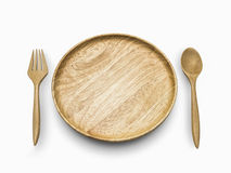 Wooden spoon and wooden fork beside the wooden dish on white isolate. Top view wooden spoon and wooden fork beside the wooden dish on white isolate Stock Images