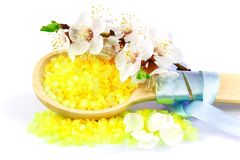Wooden spoon with yellow bath salt Stock Image