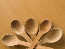 Wooden spoons. Five wooden spoons on the table Stock Images
