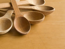 Wooden spoons. Closeup of the five wooden spoons on the wooden table Stock Photos