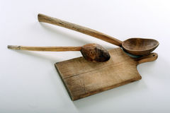 Wooden spoons. Two wooden spoons on a cutting board Stock Images
