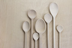 Wooden spoons. Over wooden board Royalty Free Stock Images
