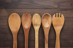Wooden spoons on the blue table Stock Images