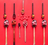 Wooden spoons with dried fruits and candied. The concept of organic products or oriental sweets stock photos
