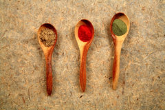 Wooden spoons and dried spices. Royalty Free Stock Photos