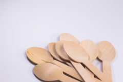 Wooden spoons. Eight wooden spoons on whith background royalty free stock image
