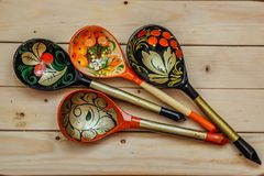 Wooden spoons with floral ornament in traditional folk Russian Khokhloma style on wooden table Royalty Free Stock Photography