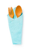 Wooden spoons and fork  in a blue cloth on white background, Cli Stock Image