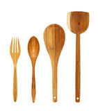 Wooden spoons and fork isolated on white royalty free stock photography
