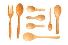 Wooden spoons and fork on white background, Clipping Path. Brown wooden spoons and fork on white background, Clipping Path Stock Photography