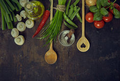 Wooden Spoons with Fresh Vegetables and Seasonings Stock Image