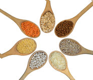 Wooden spoons full of grains Stock Photo